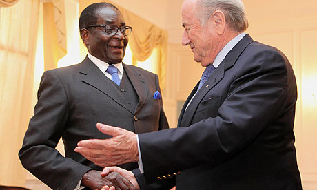 Sepp Blatter and Robert Mugabe