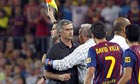 Real Madrid manager José Mourinho is restrained after Cesc Fábregas was fouled
