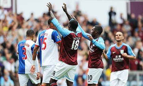 Emile Heskey, centre, celebrates scoring Aston Villa's second goal against Blackburn Rovers