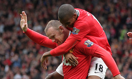 Wayne Rooney and Ashley Young celebrate