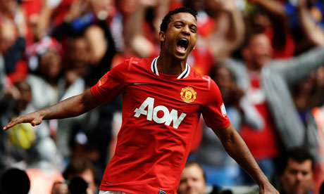 Manchester United's Nani celebrates scoring the winning goal against Manchester City