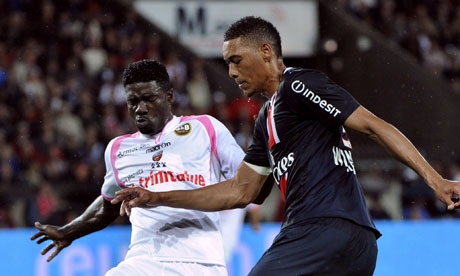Lorient's Brunoe Ecuele Manga vies with Paris Saint-Germain's Guillaume Hoarau