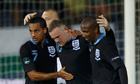 Rooney of England celebrates with teammates Walcott and Young