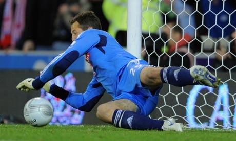 Stoke's Thomas Sorensen saves Tottenham's last penalty