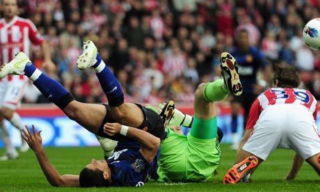 Javier Hernandez of Manchester United is tackled by Asmir Begovic