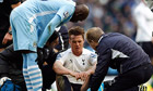 Scott Parker receives treatment after the alleged stamp by Mario Balotelli.