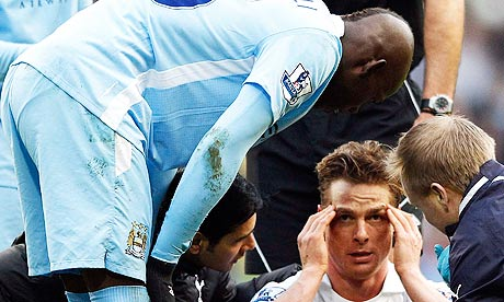 Mario Balotelli of Manchester City with Tottenham Hotspur's Scott Parker