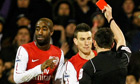 Arsenal's Johan Djourou, left is shown a red card