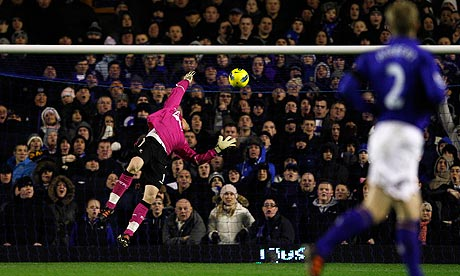 Everton's goalkeeper Tim Howard scores