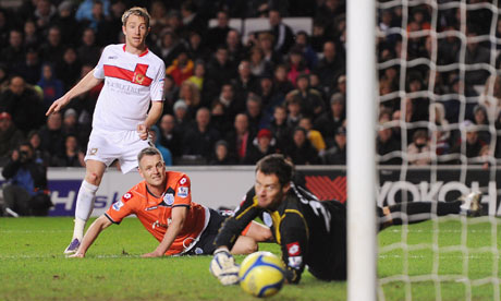 Dean Bowditch of MK Dons, left, puts his side 1-0 up against QPR in their FA Cup tie