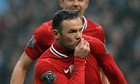 Wayne Rooney kisses his badge after scoring