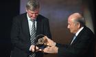 The Manchester United manager, Sir Alex Ferguson, receives the presidential award from Sepp Blatter