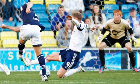 Bolton Wanderers concede a goal to Darius Henderson of Millwall