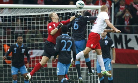 Poland's Kamil Glik scores