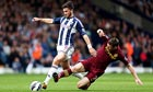 West Bromwich Albion's Shane Long is fouled by Manchester City's James Milner