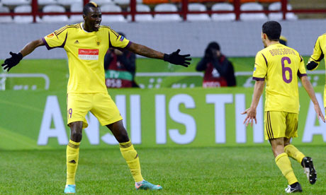Anzhi Makhachkala's Lacina Traor, left, celebrates scoring against Liverpool in the Europa League 
