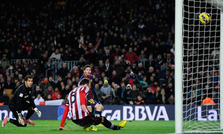 Lionel Messi of Barcelona scores his team's second in a 5-1 win over Athletic Bilbao at the Camp Nou