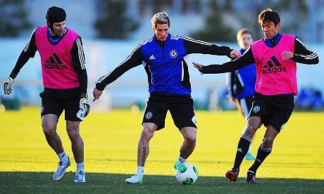 Chelsea's Petr Cech, left, Fernando Torres, centre, and Paulo Ferreira train