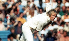 Tony Greig bowls for England in 1977
