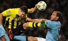 Robert Lewandowski and Pablo Zabaleta go for the ball