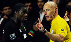 Norwich City's Sébastien Bassong speaks to the referee Howard Webb at Swansea City