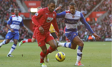 Southampton's Jason Puncheon, left, tries to hold off Reading's Adrian Mariappa.