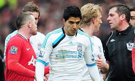 Manchester United's Wayne Rooney and Liverpool's Luis Suárez