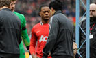 Luis Suarez refuses to shake hands with Patrice Evra