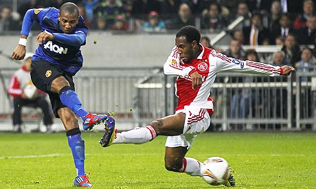 Manchester United's Ashley Young shoots to put his side 1-0 up at Ajax in the Europa League