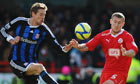 Peter Crouch tangles with Crawley's Kyle McFadzean