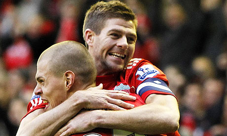 Martin Skrtel celebrates with Steven Gerrard