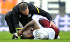 Darren Bent receives treatment at Wigan