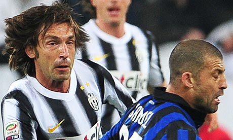 Andrea Pirlo vies with Walter Samuel