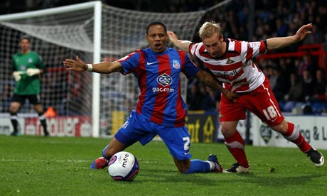 Crystal Pace's Nathaniel Clyne is fouled by Doncaster Rover's Simon Gillett
