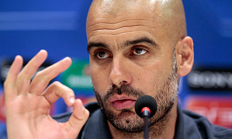 Pep Guardiola speaks to the media before Barcelona's Champions League quarter-final against Milan