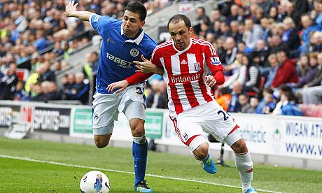 Stoke City's Matthew Etherington, right, tussles with Wigan Athletic's Antolin Alcaraz