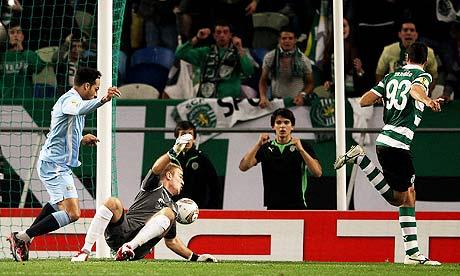 Xandão of Sporting Lisbon scores past Joe Hart of Manchester City in the Europa League