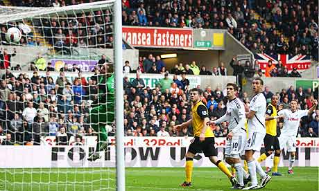 Gylfi Sigurdsson, right, of Swansea City scores his sides first goal against Blackburn Rovers