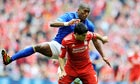 Luis Suárez of Liverpool and Sylvain Distin of Everton compete in the FA Cup semi-final at Wembley