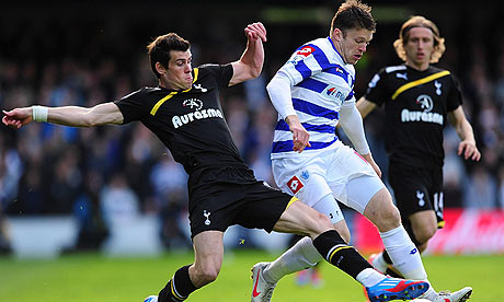 Jamie Mackie and Gareth Bale battle for the ball
