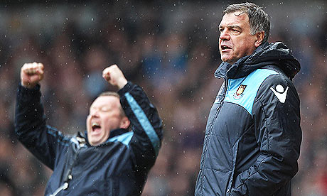 West Ham United coach Wally Downes celebrates Carlton Cole's opening goal against Hull City