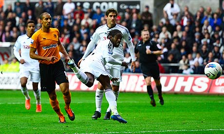 Swansea City midfielder Nathan Dyer scores his team's third goal against Wolverhampton Wanderers 