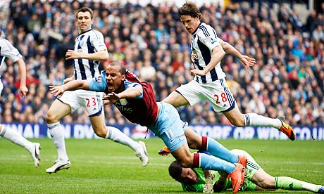Aston Villa's Gabriel Agbonlahor is brought down by West Bromwich Albion's goalkeeper Ben Foster