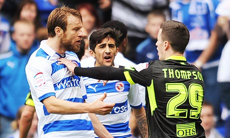 Leeds United's Zac Thompson, right, clashes with Reading's Kaspars Gorkss before being sent off