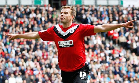 Huddersfield Town's Jordan Rhodes celebrates at Milton Keynes Dons in their League One play-off