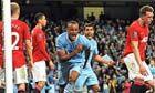 Manchester City's Vincent Kompany celebrates scoring the winner against Manchester United