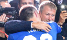 Chelsea's owner Roman Abramovich hugs John Terry after the Champions League final