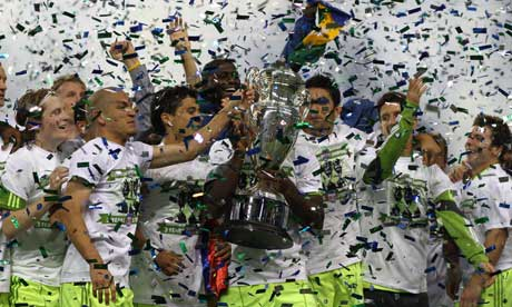 Seattle Sounders players hold the US Open Cup trophy