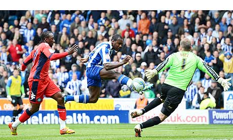 Michail Antonio of Sheffield Wednesday scores against Wycombe