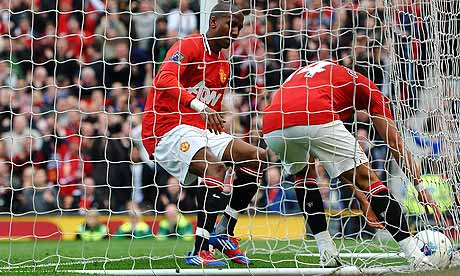 Manchester United collect the ball from the net